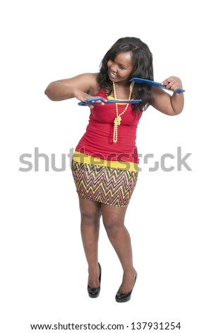 Black woman hairstylist working on doing a hair style - stock photo