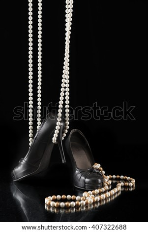 Black woman high heels summer and business shoes on black backgrounds - stock photo