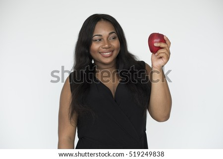 Black woman holding an apple