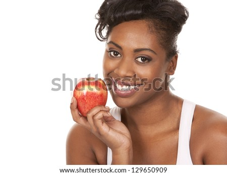 black woman holding apple on white background