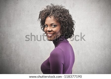Black woman, in purple, smiling - stock photo