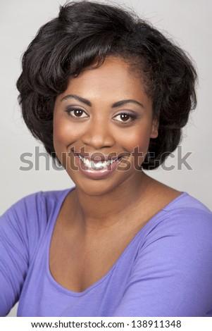 black woman portrait on grey background - stock photo