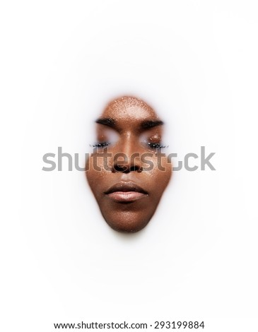 black woman's face in a milk. - stock photo