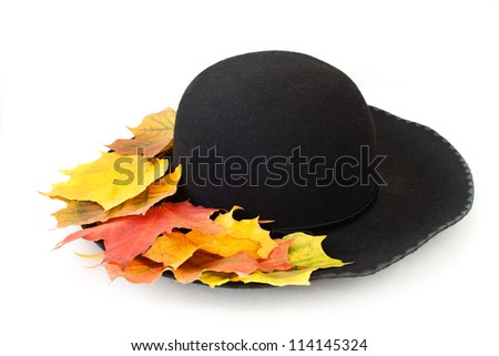 black woman's hat with autumn leaves - stock photo