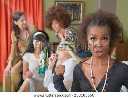 Black woman surprised with group of adults smoking pot - stock photo