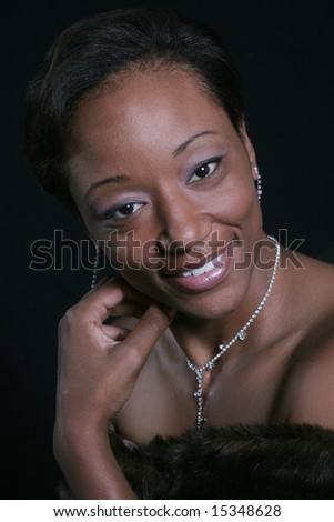 Black woman with hand on cheek - stock photo