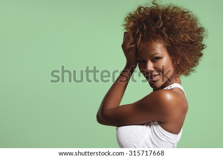 black woman with short afro hair on vivd background - stock photo
