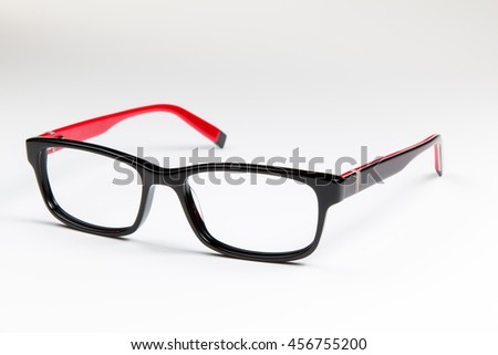 Black Women's eyeglasses with red trim on a white background.