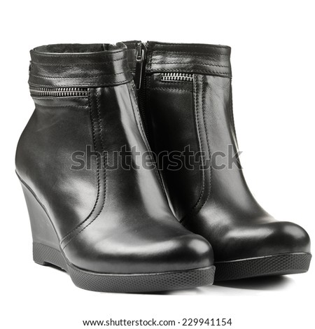 Black women's winter ankle boots with zipper isolated on white background - stock photo