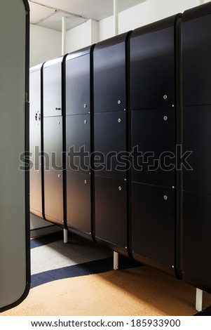 Black wood locker room at office. - stock photo