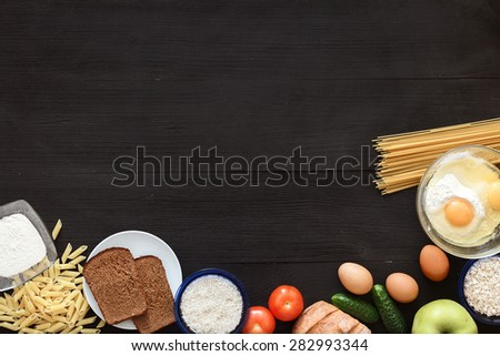 Black, wooden table top view. On the table are the food for cooking. Healthy food. Dietetic foods. Delicious breakfast. Traditional food. - stock photo