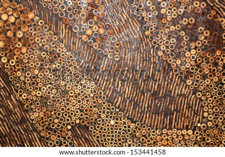Black wooden wall made from the bamboo and coconut shell. - stock photo