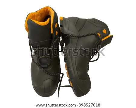 Black work boots isolated on white background. Top view.  - stock photo