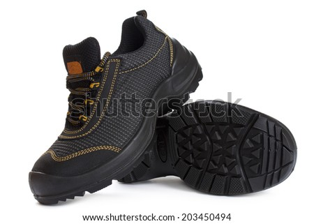 Black working boots with yellow thread isolated on white - stock photo