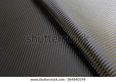 Black woven carbon fiber composite  texture for reinforcement car parts. - stock photo