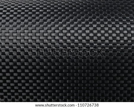 Black woven carbon fibre texture pattern background - stock photo