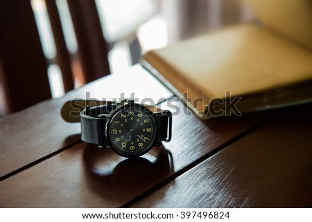 black wristwatch vintage  - stock photo