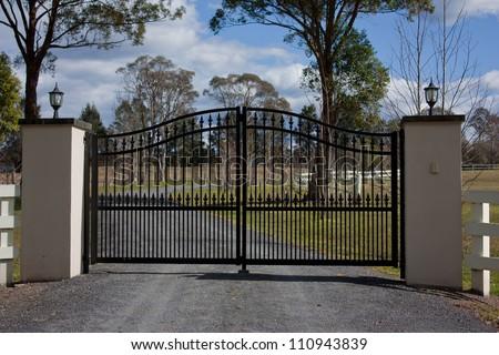 Black Wrought Iron Entrance Gates Rural Stock Photo