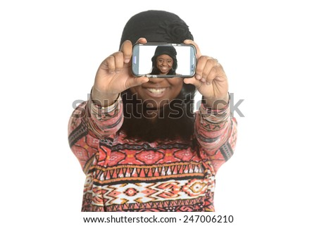 Black young woman taking a selfie isolated on a white background - stock photo