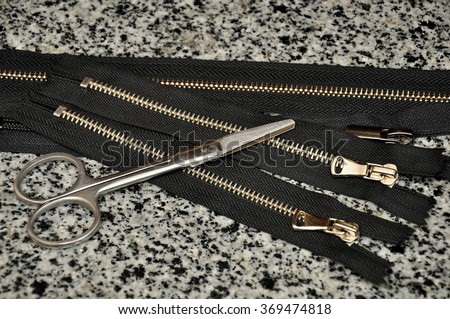 Black zipper close up. Many black zippers background. - stock photo
