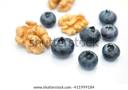 Blackberies and walnuts isolated on white background. - stock photo