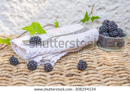 Blackberry and green leaves with natural background. - stock photo