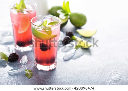 Blackberry and lime refreshing summer cocktail with lemonade