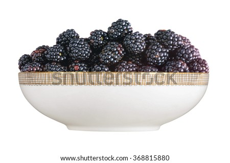 Blackberry in plate isolated on white background - stock photo