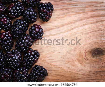 Blackberry on Wooden Background - stock photo