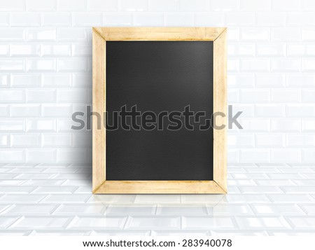 Blackboard at white tiles ceramic room,Business mock up for display your design - stock photo