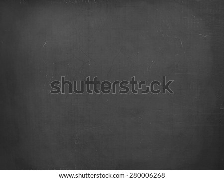 Blackboard / chalkboard texture. Empty blank black chalkboard with chalk traces - stock photo