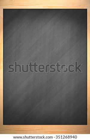 Blackboard in wooden frame with chalk and eraser
