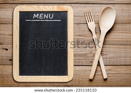 Blackboard menu and wooden fork and spoon - stock photo