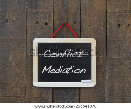 Blackboard old wooden with word conflict and mediation. - stock photo