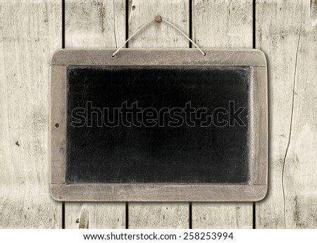 Blackboard on a old white wood wall background texture - stock photo