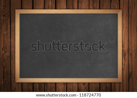 Blackboard on a wooden wall - stock photo