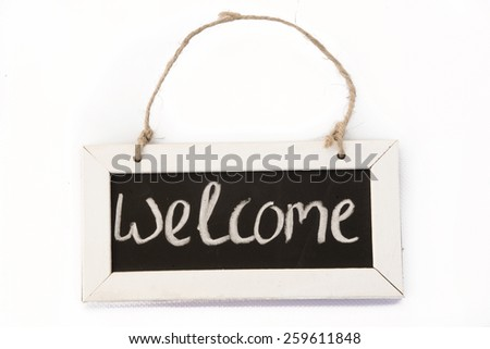 blackboard on rope 'welcome' - stock photo