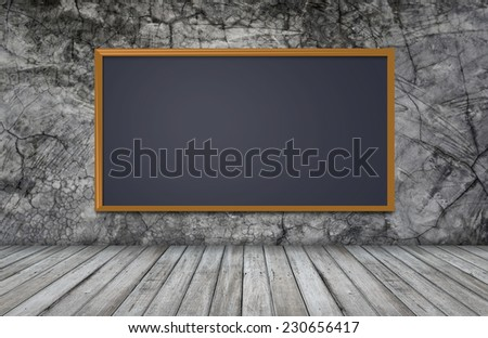 blackboard on wall with wooden table for design