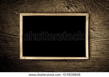blackboard on wooden plate background - stock photo
