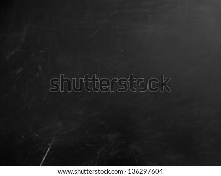 Blackboard texture. Empty blank black chalkboard with chalk traces - stock photo