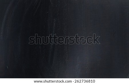 Blackboard texture. Empty blank black chalkboard with chalk traces - stock photo