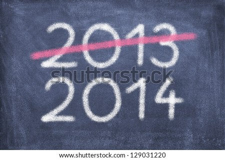Blackboard with 2013 and 2014/New Year/2014 - stock photo