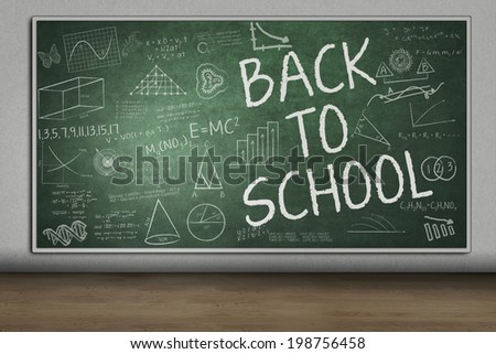 Blackboard with Back to School text in the school - stock photo
