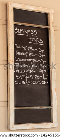 Blackboard with business hours