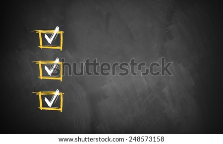 blackboard with 3 checked rows ready for customization with own checklist items - stock photo