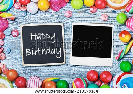 blackboard with congratulations to the happy birthday and photo frame - stock photo
