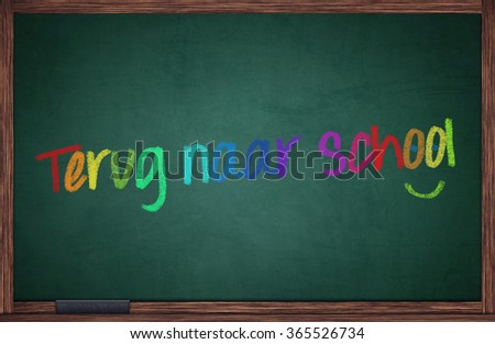 Blackboard with dutch words for back to school and happy face - stock photo