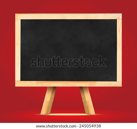 Blackboard with easel in red studio room wall,Template for your content. - stock photo