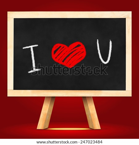 "Blackboard with easel with ""I love you"" word in red studio room wall,Love concept - stock photo"
