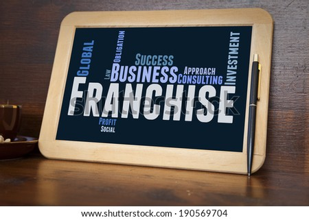 blackboard with franchise word cloud - stock photo